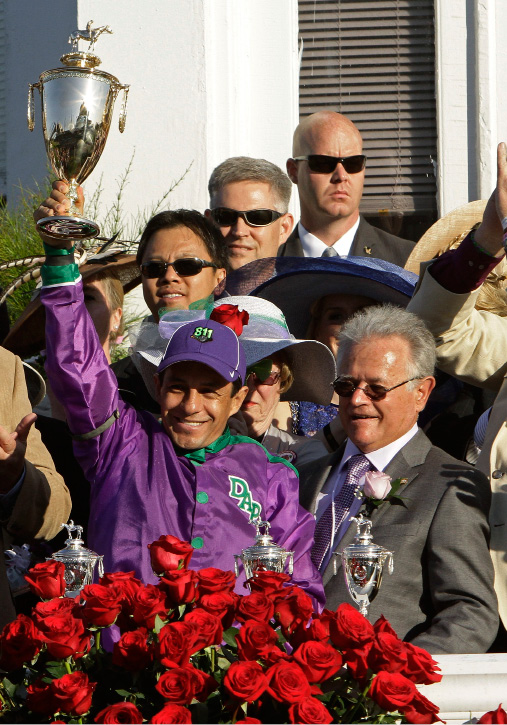 Victor Espinoza and trainer Art Sherman celebrate after Espinoza rode California Chrome to a victory in the 140th running of the Kentucky Derby horse race at Churchill Downs Saturday, May 3, 2014, in Louisville, Ky. (AP Photo/Garry Jones)