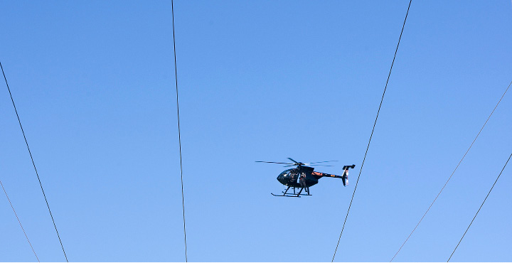 A helicopter crew from Pennsylvania based Haverfield Aviation, inspects transmission lines near Meriden Markham Airport, Tuesday, August 23, 2016. Frank Poirot, a spokesman for Eversource Energy, said the crew will be flying over lines in the central and northeastern part of the state over the next few weeks.    | Dave Zajac, Record-Journal