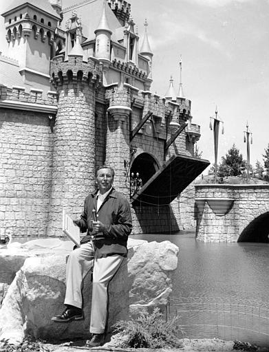 Walt Disney sits on a rock in front of the Sleeping Beauty Castle in the Fantasyland section of Disneyland on opening day of the amusement theme park in Anaheim, Ca., on July 17, 1955.   (AP Photo)