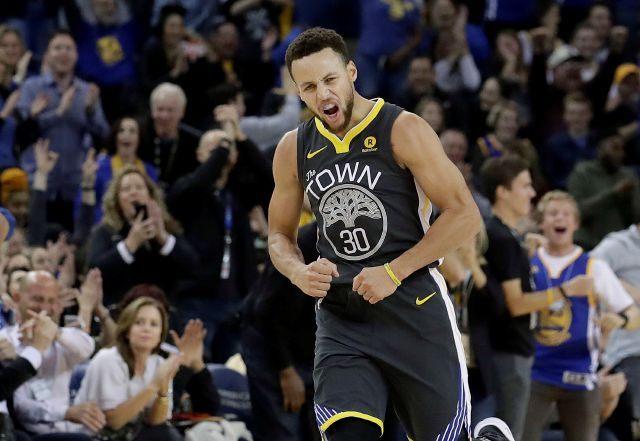 Golden State Warriors guard Stephen Curry reacts after scoring during the first half of the team