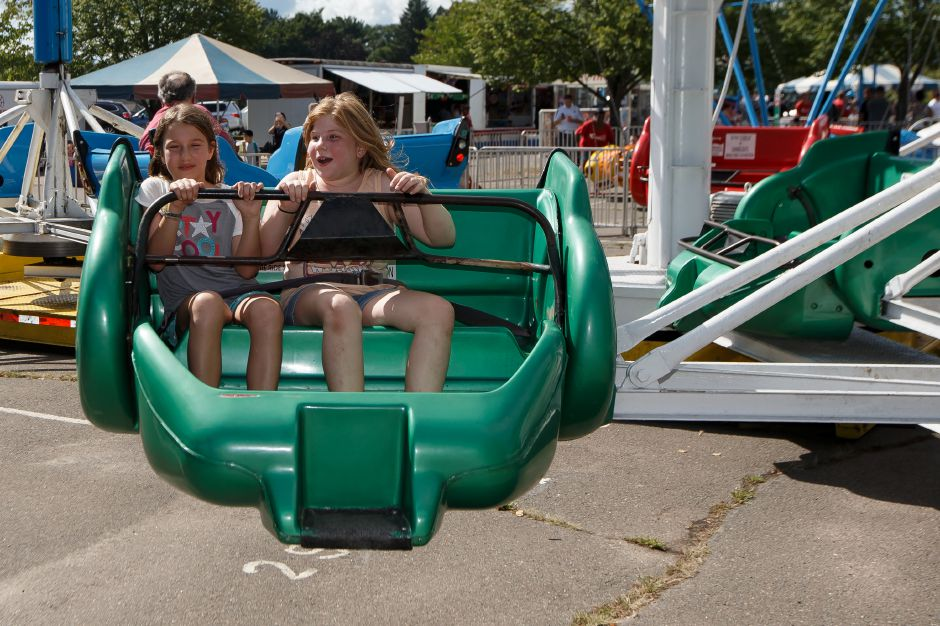 Erin Glatt-Deeley 10 left and friend Gracie Thomas 10 of Cheshire ride the Sizzler Saturday during the Cheshire Fall Festival in Bartlem Park Cheshire September 15, 2018 | Justin Weekes / Special to the Record-Journal