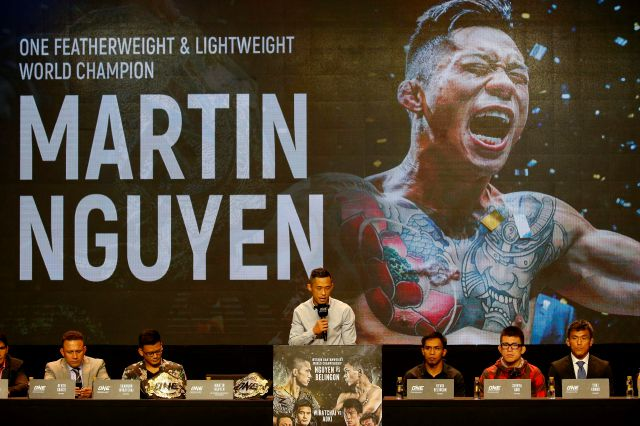 FILE - In this July 24, 2018, file photo, reigning ONE featherweight and lightweight world champion Martin Nguyen addresses reporters during a news conference for the ONE Championship mixed martial arts event in Pasay city, south of Manila, Philippines. One Championship, the MMA organization out of Asia, is going global in 2019 and it