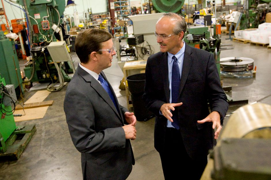 Douglas Johnson, president of Marion Manufacturing, center, gives a tour of the Cheshire based business to Sen. Chris Murphy (D) who was visiting as part of his efforts to reduce exemptions to the federal Buy American Act. | Dave Zajac / Record-Journal