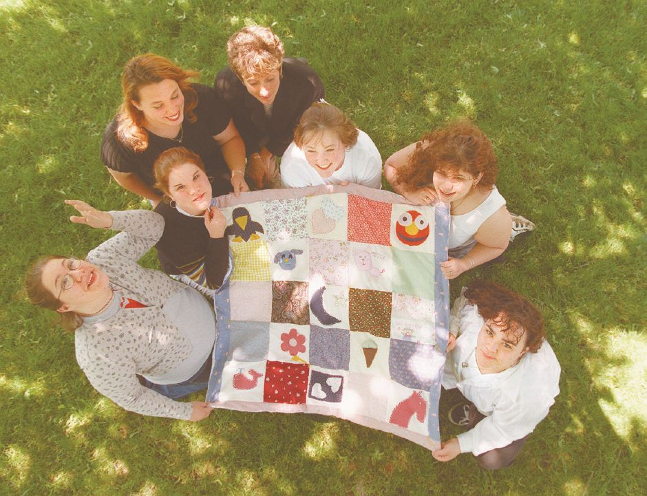 RJ file photo - From left, Shawna Freeman, Karen Hally, Adrian Barbieri, Marty Barracato, Lauren Murphy, Laura Songhurst and Denise Omerato show off the quilt that Lyman Hall High School students made for the Ronald McDonald House, May 1998.
