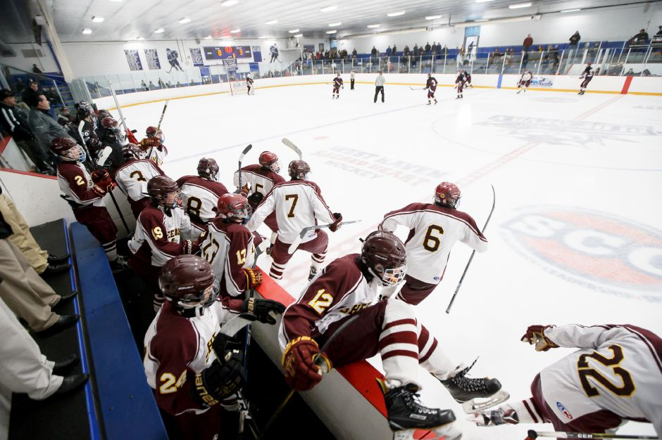 The Sheehan Titans clear the bench after the final horn sounds on their 8-3 victory over BBD in the SCC/SWC Division III championship game Saturday at Bennett Rink. | Justin Weekes / Special to the Record-Journal
