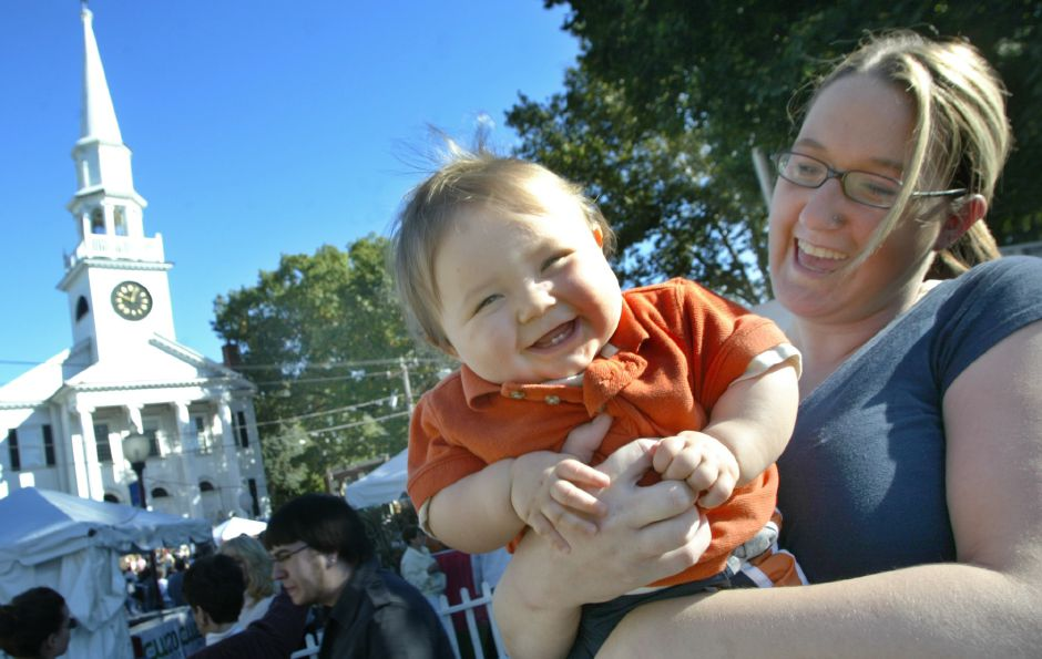 Brian Cochran, 8 mos. of Southington is held by mother Tara while enjoying the 2006 Apple Harvest parade in Southington Sunday afternoon, October 8, 2006. (dave zajac photo)