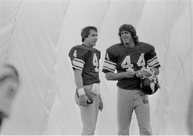 Former Houston Oilers quarterback Archie Manning, left, and tight end Dave Casper chat near the end of their first day of practice as Minnesota Vikings in Eden Prairie, Minn., Sept. 21, 1983. The two were traded to the Vikings for future draft considerations. (AP Photo/Jim Mone)