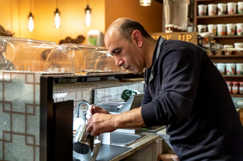 Tigran Hovhannisyan, of Berlin, makes a coffee at his newly opened cafe Busy Bean Coffee on Main Street, Berlin. The cafe opened on Feb. 4, 2019. | Devin Leith-Yessian/Berlin Citizen