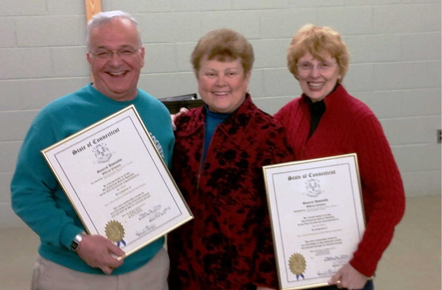 FILE PHOTO: Plainville Chorale Society Director Peter Peluso and his wife, Maryjane, right, were awarded a special citation by state Rep. Betty Boukus for their years of service to PCS. The chorale society is readying for a performance Friday, March 13.