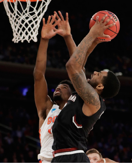 South Carolina guard Sindarius Thornwell (0) puts up a shot against Florida forward Kevarrius Hayes (13) during the second half of the East Regional championship game of the NCAA men