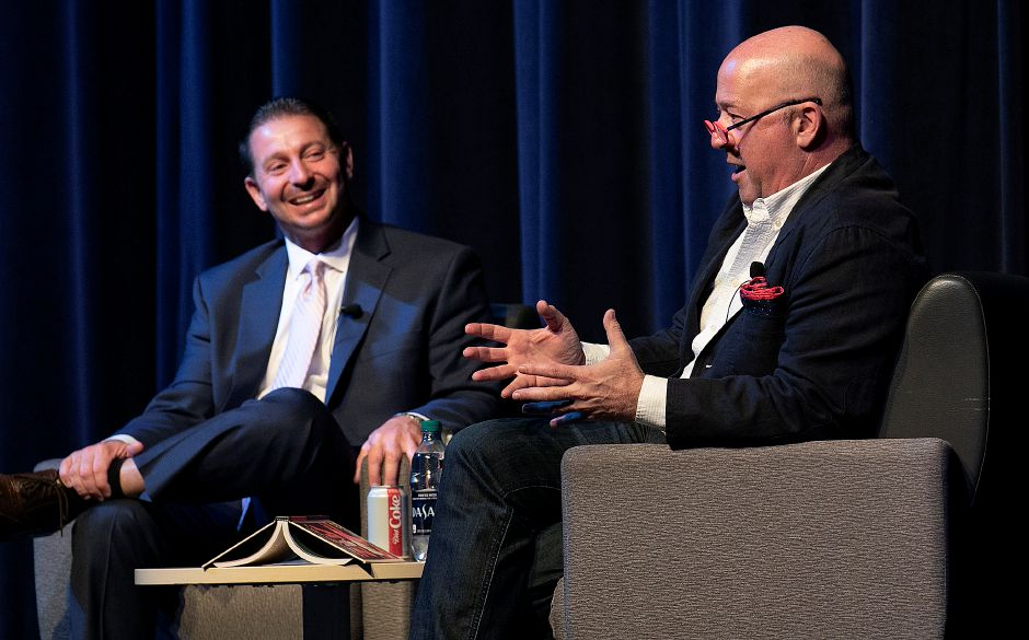 "Author Andrew Zimmern gives a talk at Platt High School next to Superintendent of Schools Mark Benigni, Wed., May 15, 2019. Zimmern is the globe-trotting host of the ""Bizarre Foods"" TV show. Dave Zajac, Record-Journal"