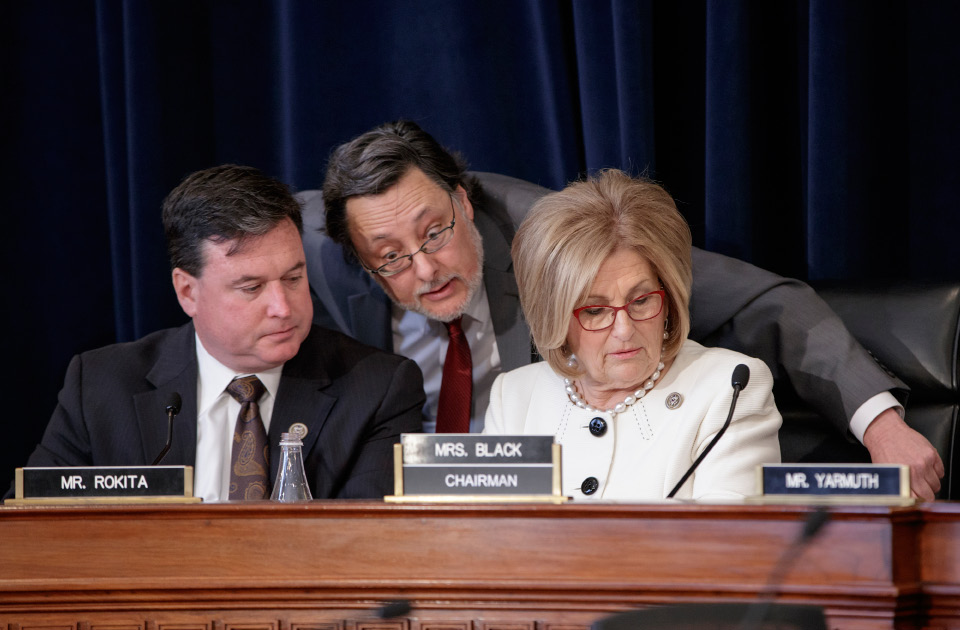 House Budget Committee Chair Diane Black, R-Tenn., right, joined at left by Rep. Todd Rokita, R-Ind., and panel staff member Jim Bates, center, works on the Republican health care bill, on Capitol Hill in Washington, Thursday, March, 16, 2017. (AP Photo/J. Scott Applewhite)