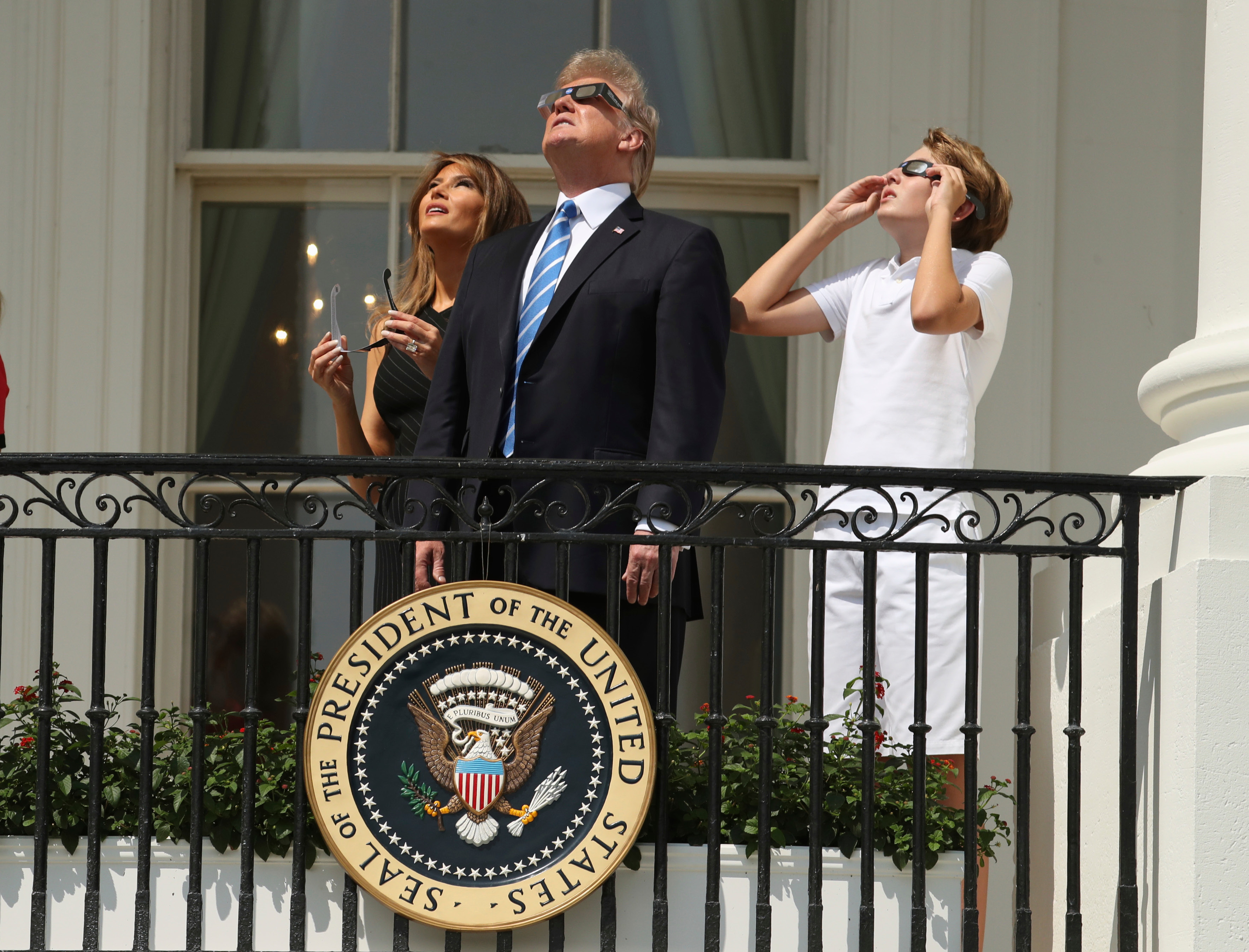 President Donald Trump, first lady Melania Trump and their son Barron watch the solar eclipse, Monday, Aug. 21, 2017, at the White House in Washington.  (AP Andrew Harnik)
