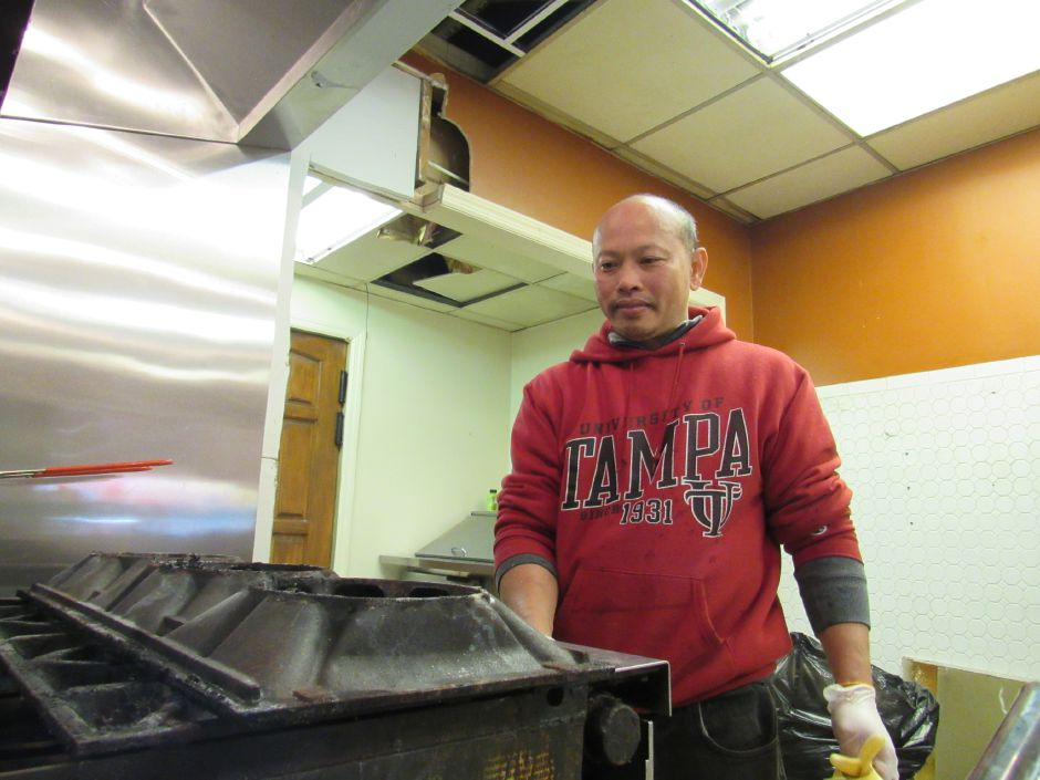 Phangphan Phatphongvet, owner of Uncle Jack Thai Restaurant, tests the stove at his downtown Plantsville location Friday,. He hopes to open in the next few weeks | Jesse Buchanan