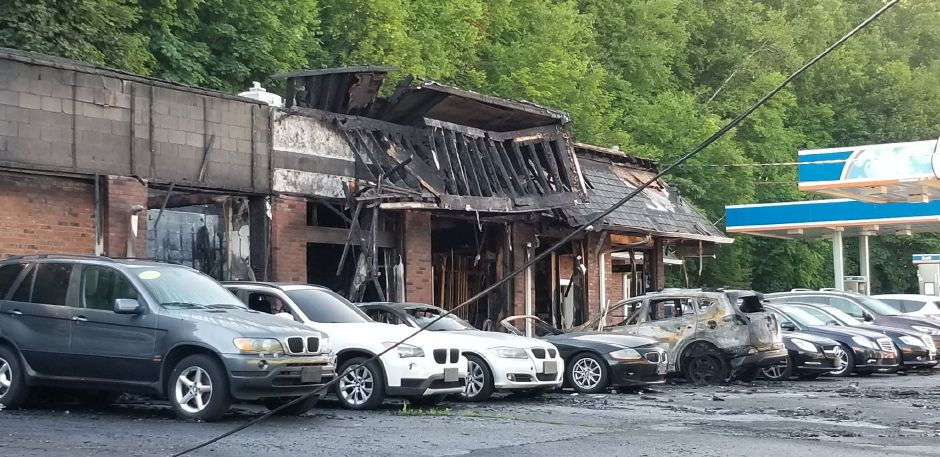 Authorities are investigating an arson fire earlier this month a Five Stars Cars dealership on North Broad Street in Meriden.