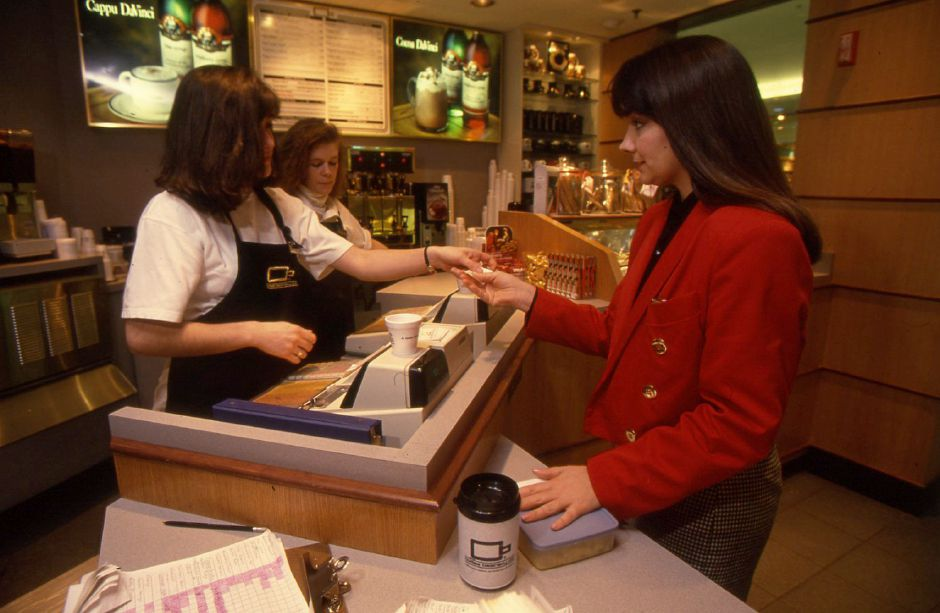 RJ file photo - Martha Miller of Cromwell says she is a regular customer of The Coffee Beanery Ltd. in Meriden Square, Jan. 5, 1994.