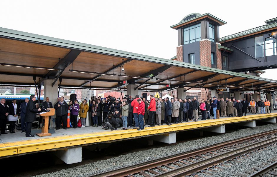 Gov. Dannel P. Malloy, left, speaks at the Meriden train station, Thursday, April 19, 2018. State and city leaders crowded onto the platform at the new Meriden train station to cut the ribbon on the CTrail Hartford Line, which officials hope will provide an alternative option for commuters and potentially ease highway congestion. Dave Zajac, Record-Journal