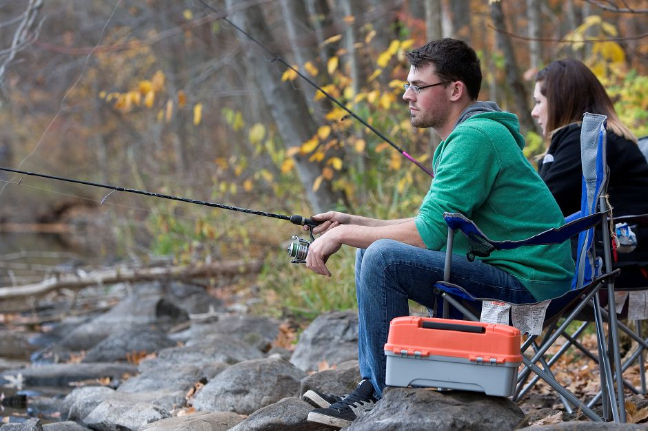 Crescent Lake ranks third on TripAdvisor.com's list of things to do in Southington. In this file photo, Cody Pollin and Jennifer Fontaine, of Plainville, wait for a bite while fishing on November 5, 2015. | Dave Zajac / Record-Journal