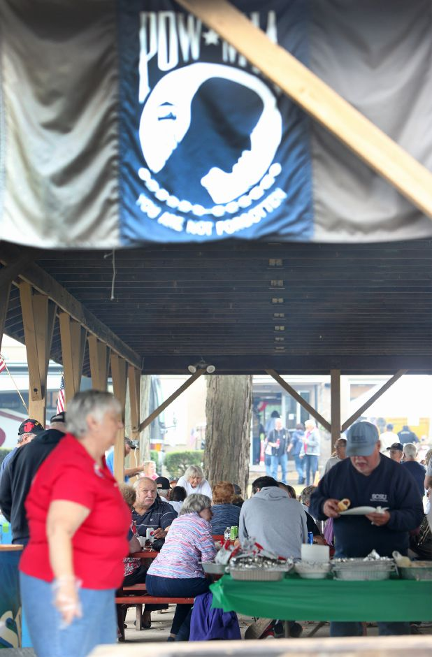 Guests take shelter from the rain during the celebration of the American Legion's 100th anniversary at the annual American Legion Post 45 All American Picnic in Meriden on Saturday, Sept. 14, 2019. Emily J. Tilley, special to the Record-Journal.