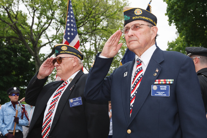 Moe Robitaille Jr. left and Wayne White salute during the opening of the Memorial Day ceremonies in Southington Monday  May,26 2014 | Justin Weekes / For the Record-Journal