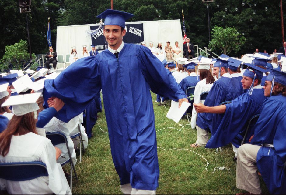 RJ file photo - David Zyjewski, the last graduate to recieve his diploma, also recieves congratulations and comradery amongst his fellow classmates at Lyman Hall graduation Friday night June 25, 1999.