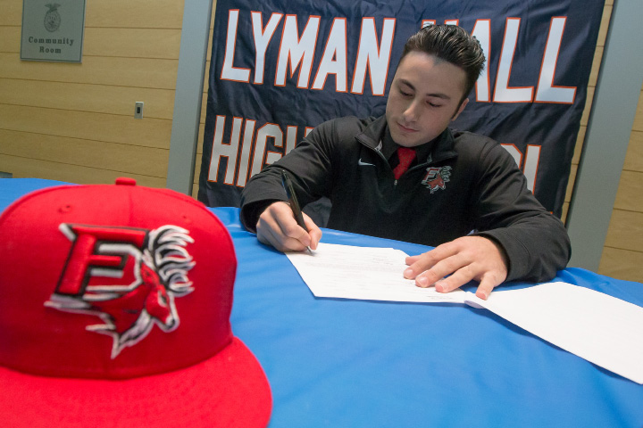 Lyman Hall's Mike Caruso signs his letter of intent to play Division I baseball at Fairfield University Wednesday at  Lyman Hall High School in Wallingford. | Justin Weekes, Special to the Record-Journal