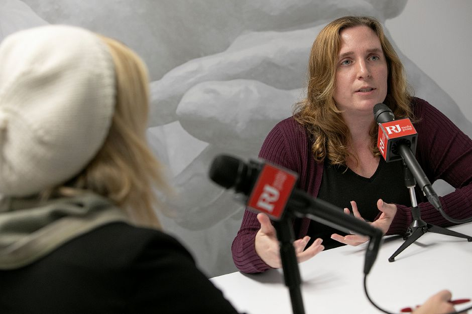 "Sarah DiMeo, right, producer of ""Faded Out,"" discusses her podcast series at the Record-Journal in Meriden, Fri., Dec. 7, 2018. DiMeo"