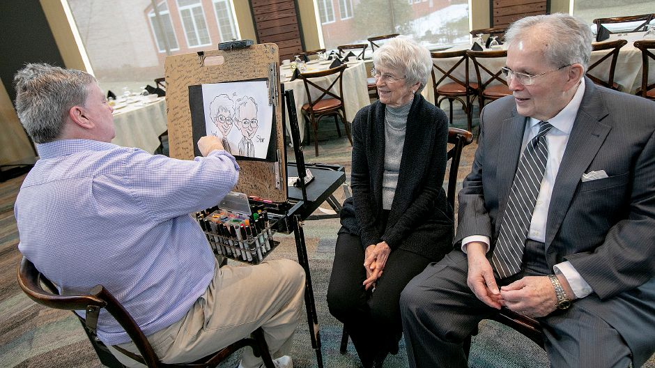 Artist Don Landgren Jr., left, sketches a portrait of Elim Park residents Lori and Steve Robey during the annual senior citizen prom for residents of Elim Park, Fri., Mar. 1, 2019. The prom was organized by members of the Student Nurses Association at Quinnipiac University. Dave Zajac, Record-Journal