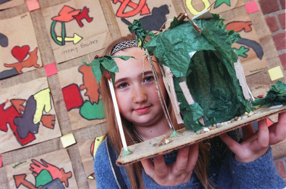 RJ file photo - Alicia Daubert, a fifth-grader at Nathan Hale School in Meriden, holds up her Symbols of Survival project that she make in class, May 1999.