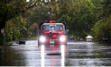 A fire truck drives through a flooded neighborhood, in the aftermath of Hurricane Irma, in Bonita Springs, Fla., Monday, Sept. 11, 2017. (AP Photo/Gerald Herbert)