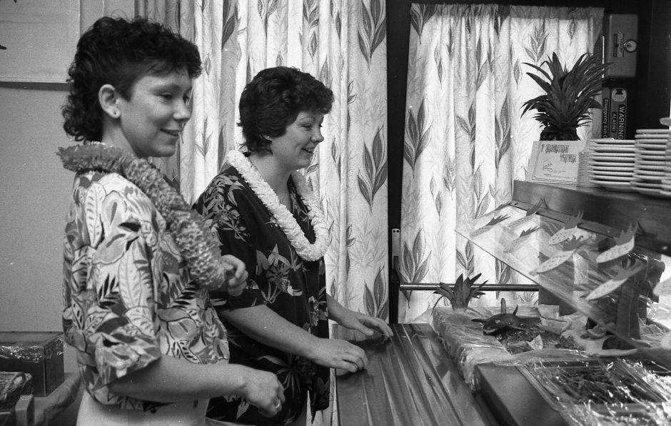 RJ file photo - Bradley Memorial Hospital cafeteria workers Heather Krieg and Donna Marcuccio check out the island scene set up for Hawaii Day Aug. 2, 1989.