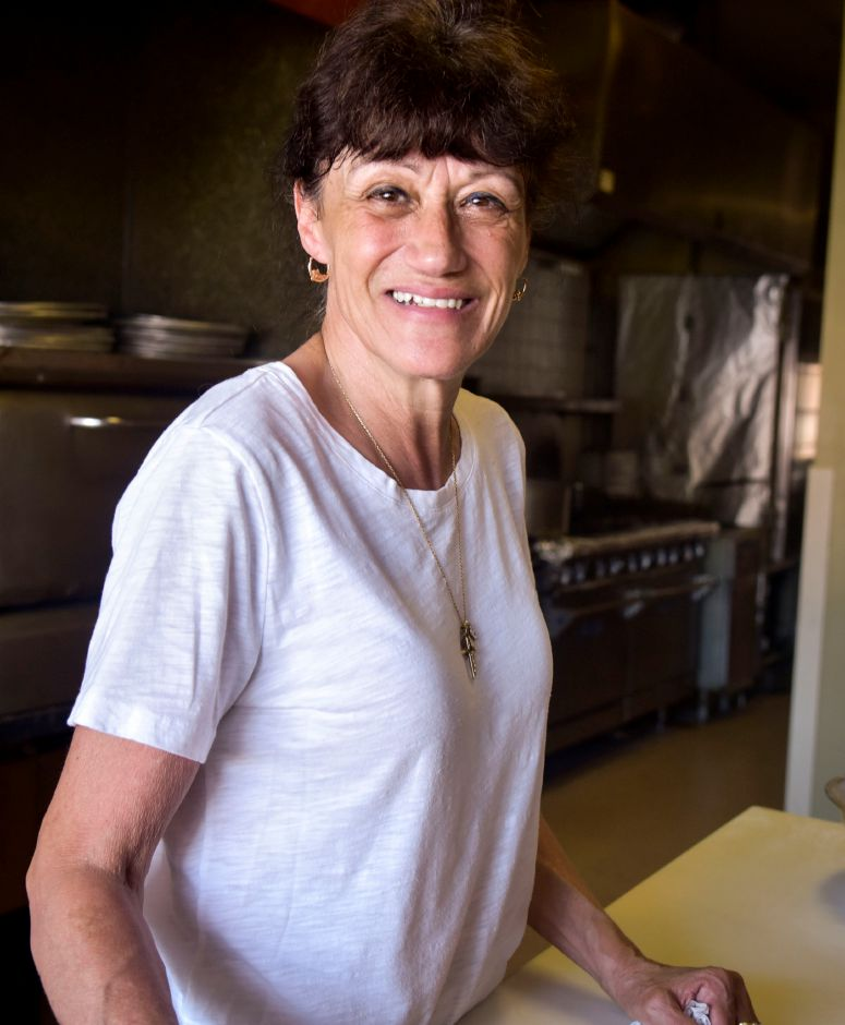 Cindy Fiorentino, owner of Stella Pizza & Restaurant on South Colony Road in Wallingford, poses at the restaurant on Friday, August 24. Community support helped Fiorentino reopen the restaurant after it was forced to close for 13 days of uncertainy due to financial hardship. | Bailey Wright, Record-Journal