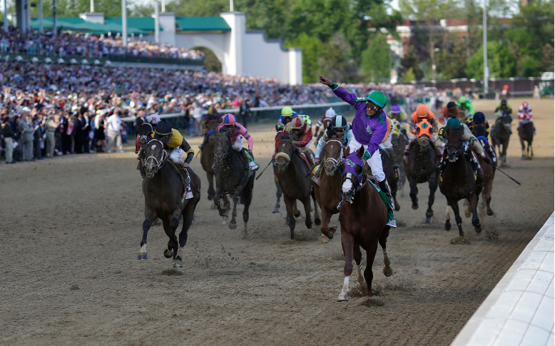 Victor Espinoza, front right, rides California Chrome to a victory during the 140th running of the Kentucky Derby horse race at Churchill Downs Saturday, May 3, 2014, in Louisville, Ky.(AP Photo/David J. Phillip)