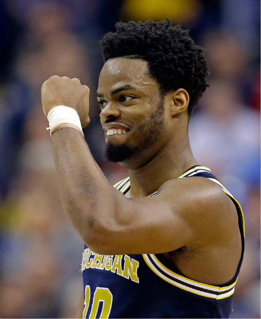 Michigan guard Derrick Walton Jr. (10) celebrates a 73-69 win over Louisville in a second-round game in the mens NCAA college basketball tournament in Indianapolis, Sunday, March 19, 2017. (AP Photo/Michael Conroy)