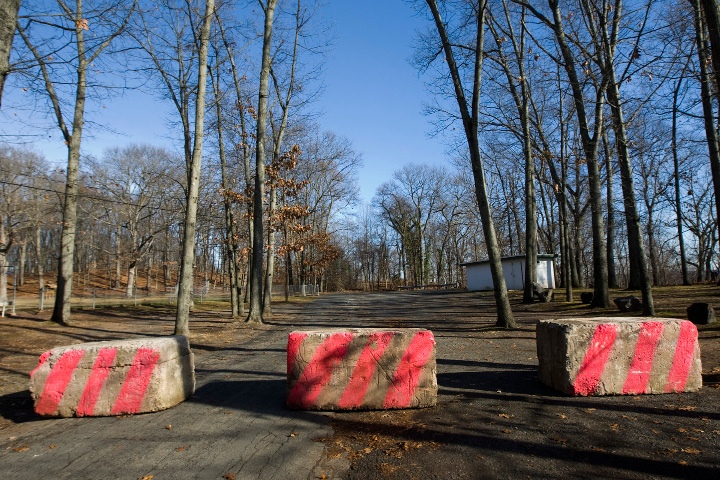 Concrete blocks prevent access to a portion of Lufbery Park in Wallingford, Tuesday, December 13, 2016. The barricade was set up to deter potential illegal dumping.  | Dave Zajac, Record-Journal