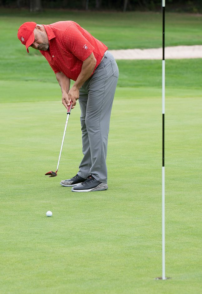 Wallie Feliciano, of Meriden, putts for birdie on the 9th hole during the annual Hunter
