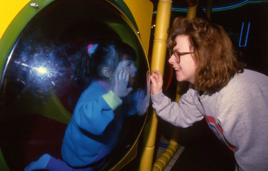 RJ file photo - Lynn Canalia looks at her daughter, Jill, inside the Space Challenge play land at the Meriden Square, Feb. 1994.