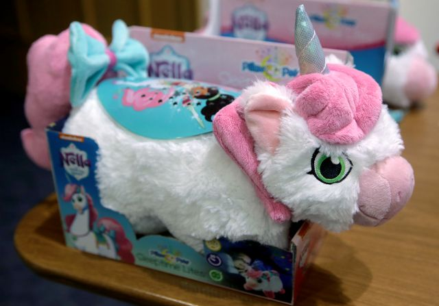 "A battery-lighted unicorn plush toy of the Nickelodeon character Nella that is part of a product line called ""Pillow Pets Sleeptime Lite,"" which is on the World Against Toys Causing Harm, or W.A.T.C.H., list of worst toys for the holiday season, rests on a table before a news conference, Tuesday, Nov. 13, 2018, at a hospital, in Boston. The Massachusetts-based consumer safety group says the toy has small felt-like accessories attached to it that if removed pose potential ingestion hazards. (AP Photo/Steven Senne)"