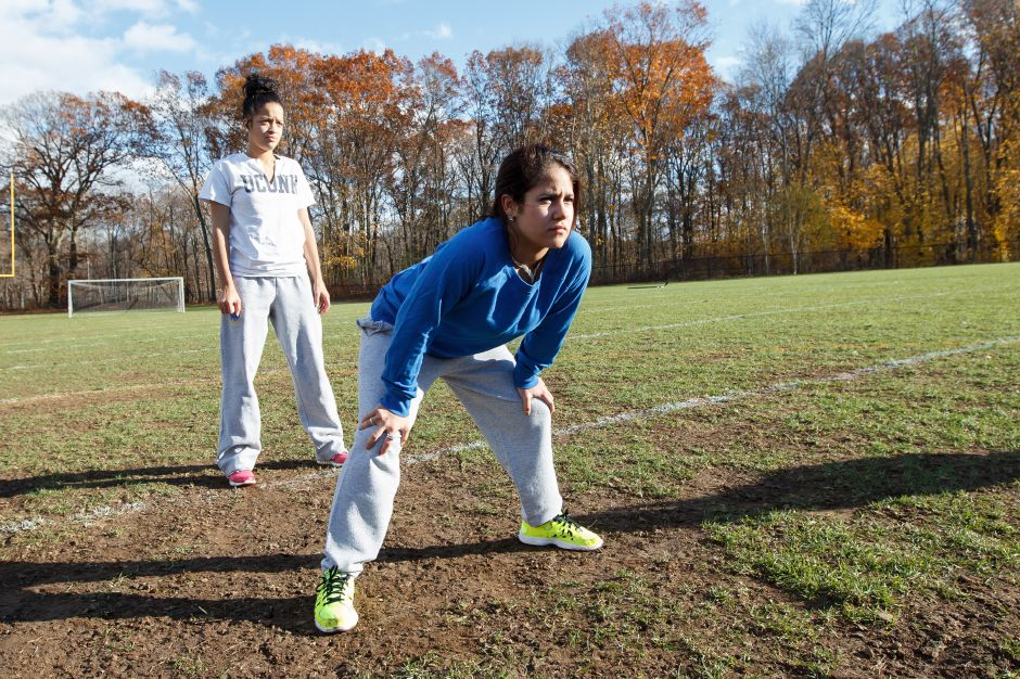 Alexia McClammy 18 left and Ashley Cintron 17 line up with the offense Friday during Powder Puff practice at Wilcox Tech in Meriden Nov 14, 2014 | Justin Weekes / For the Record-Journal