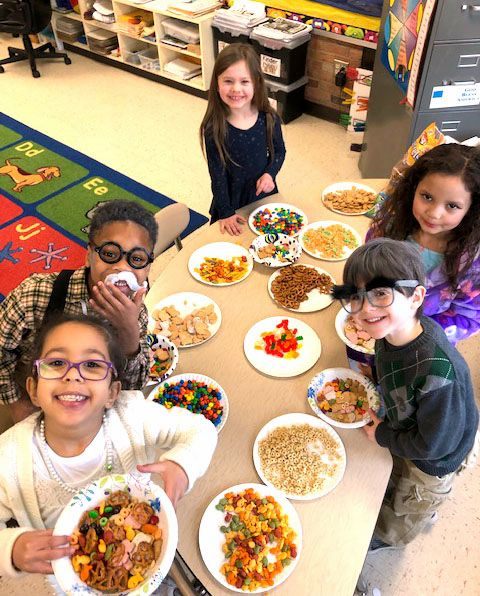 Payton Wrinn, Delilah Ortiz, Jacob Stopa, Jenee Jefferson, Kairon Armstrong  counted out 10 groups of 10 snacks to make a fun trail mix!