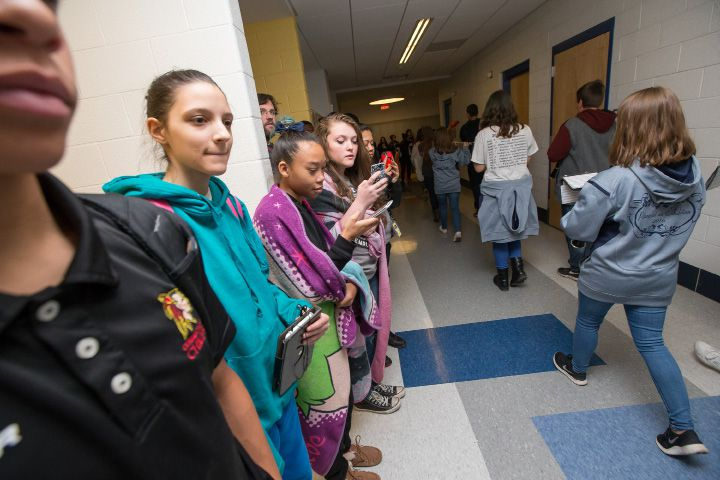 Platt students lines the hallways as the pep rally parade passed Wednesday during the Platt pep rally at Platt High School in Meriden Nov. 23, 2016 | Justin Weekes / For the Record-Journal