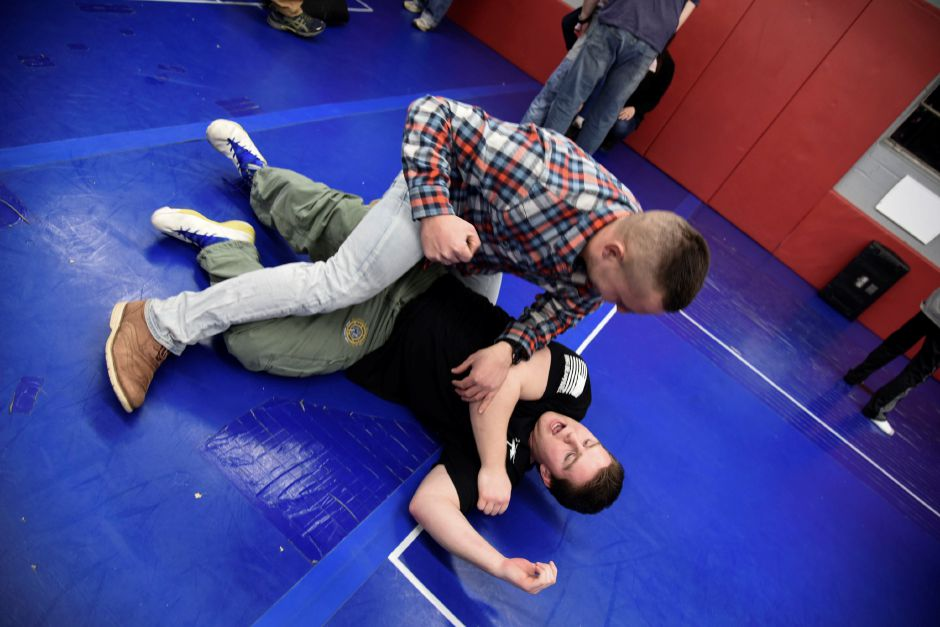 "Expert Instructor Mark Visconti (bottom) coaches Southington resident Adam Tokarzewski through a tackle, during the ""fight"" lesson of staying safe in an active shooter senario, at Krav Maga Southington in Plantsville Friday, Feb. 23. 