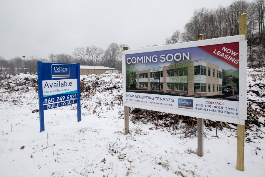 Signs posted on land at 1336 E. Main St. in Meriden Wednesday announce plans for a new office building. A local developer won Planning Commission approval to build the structure on the vacant lot located next to the Family Dollar store. Dave Zajac, Record-Journal