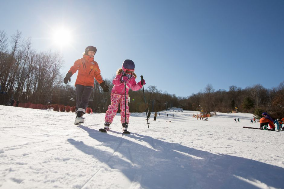 Fiona Shaw, 7, of Newtown, learns to ski for the first time with instructor Sarah Norback Friday at Mount Southington in Plantsville Dec. 29, 2017 | Justin Weekes / Special to the Record-Journal