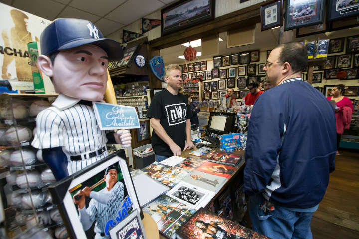John Kelleher owner of M & J Video Game and First Base Collectables talks with Chris Andrea of East Haven as they wait the arrival of pro wrestler Kevin Nash Saturday in Wallingford Jan. 30, 2016 | Justin Weekes / For the Record-Journal