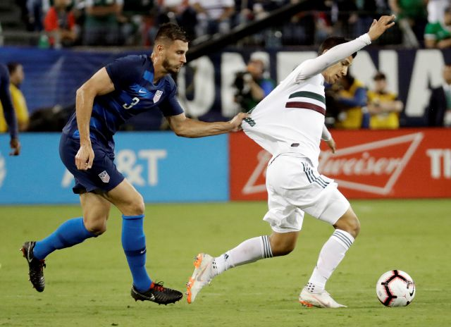 United States defenseman Matt Miazga (3) grabs the jersey of Mexico forward Angel Zaldivar, right, during an international friendly match Tuesday, Sept. 11, 2018, in Nashville, Tenn. (AP Photo/Mark Humphrey)