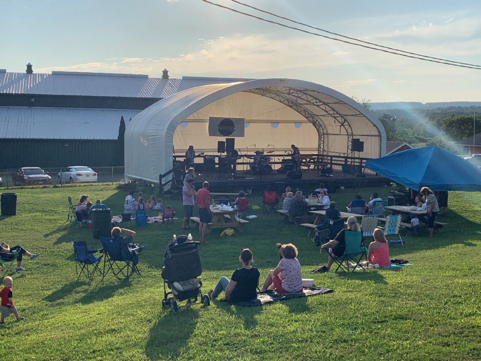 Photo of the crowd and Nitefall as they took the stage to close out the 2019 Durham Summer Concert Series. Photo by Everett Bishop, Town Times.