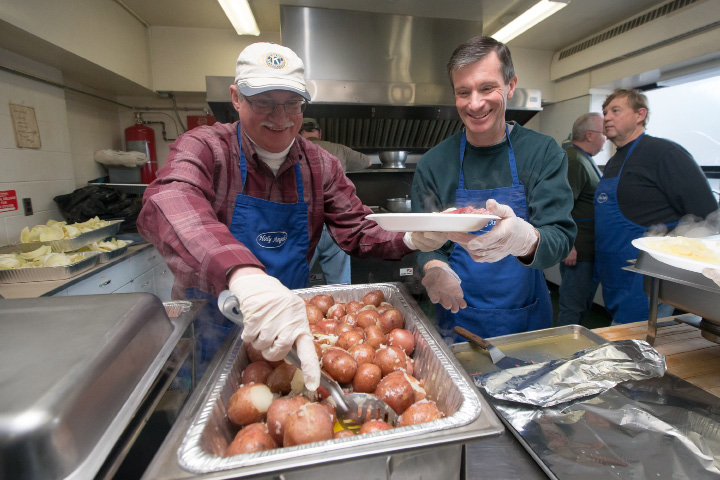 Dave Wyskiel, left, and Mike Cavaliere, both of Meriden, plate the corned beef and potatoes for guests Sunday at the St. Patrick's Day dinner at Holy Angels Church in Meriden.