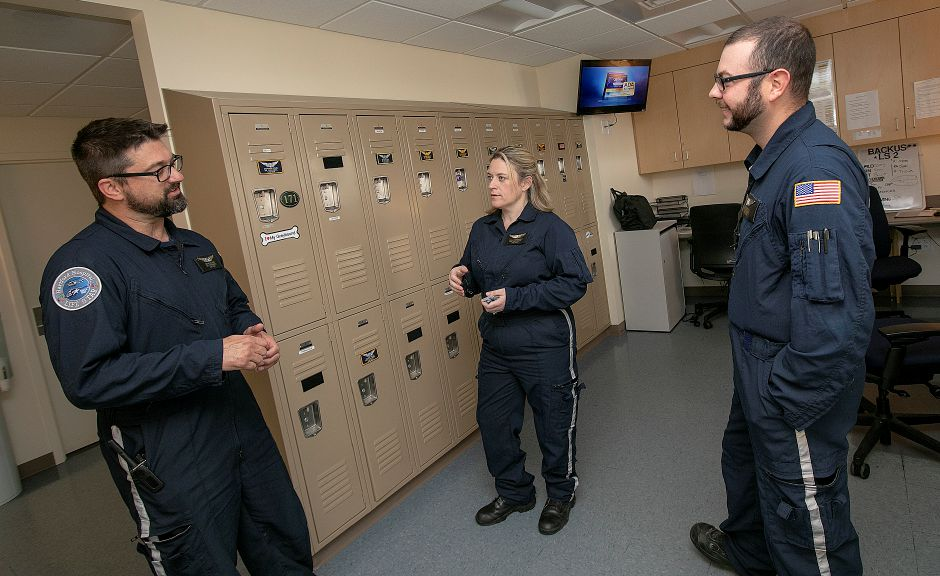 Tricia Margarido, a respiratory therapist with Life Star, talks with crewmates, Brian Wilson, nurse paramedic, left, and Tom Bascetta, respiratory therapist, Friday, August 31, 2018. Margarido has taken on more leadership responsibilities over the years, now serving as a medical crew manager. Dave Zajac, Record-Journal