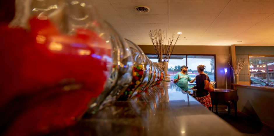Jars of candy line the counter at the front desk of the Square Foot Lounge in Wallingford Aug. 7, 2019. | Richie Rathsack, Record-Journal